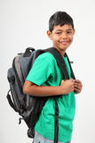 Happy primary school boy age 10 with backpack Stock Images