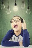 Happy primary school student get solution Royalty Free Stock Image