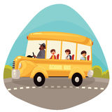 Happy primary students riding school bus Stock Photography