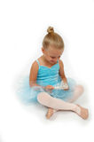 Happy Princess Ballerina. Ballerina sits with her crown in her hands Stock Photos