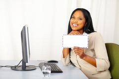 Happy professional businesswoman showing a letter Stock Photography