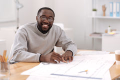Happy professional engineer being involved in his project. Modern engineering. Happy professional good looking engineer holding a pencil and doing a drawing Royalty Free Stock Photos