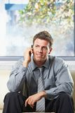 Happy professional getting news on phone Stock Photos