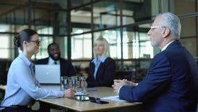 Happy professional office workers talking meeting room, team briefing, good news
