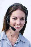 Happy professional recepcionist. Happy phone operator answering costumers telephone calls Stock Photography