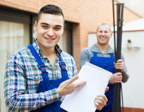 Happy professional workers in uniform Royalty Free Stock Photography