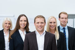 Happy professional young team wearing formal suits. Happy professional young team made of three women and two men, all Caucasian, looking at camera and wearing Royalty Free Stock Photography