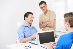 Happy with the project results. Three business people working on Stock Photo
