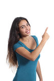 Happy promoter teen girl presenting and pointing at side Royalty Free Stock Photo