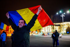 Happy protester with romanian flag, Bucharest, Romania Royalty Free Stock Photos