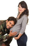 Happy proud military soldier hugging pregnant wife royalty free stock image
