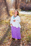 Happy proud pregnant woman. In fall nature Royalty Free Stock Image