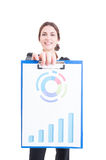 Happy and proud sales woman holding clipboard with financial cha Stock Photo