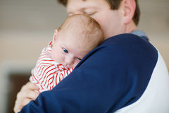 Happy proud young father with newborn baby daughter, family portrait togehter Stock Images
