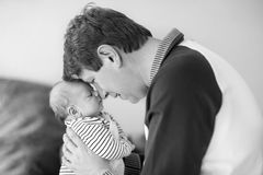 Happy proud young father with newborn baby daughter, family portrait togehter. Happy proud young father having fun with newborn baby daughter, family portrait royalty free stock photo