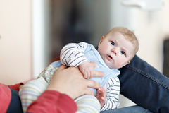 Happy proud young father with newborn baby daughter, family portrait togehter Stock Photo