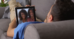 Happy Puerto Rican friends talking on tablet Stock Images