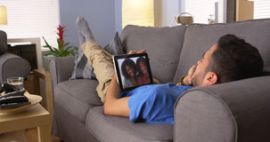 Happy Puerto Rican friends talking on tablet Royalty Free Stock Image