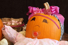 Happy Pumpkin Baby with Presents Stock Photo