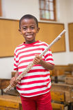 Happy pupil holding flute Royalty Free Stock Photography