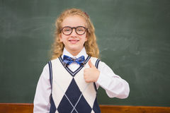 Happy pupil looking at camera with thumb up Stock Photography