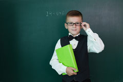 Happy pupil with schoolbook Stock Photography
