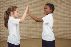 Happy pupils giving each other a high five Stock Photo