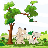 Happy puppies under the tree Royalty Free Stock Images