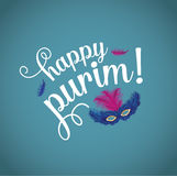 Happy Purim with feathered mask Stock Images