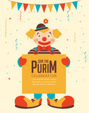 Happy purim, jewish holiday. clown holding greeting poster Royalty Free Stock Photography
