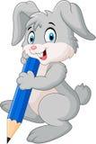 Happy rabbit cartoon holding pencil Stock Photo