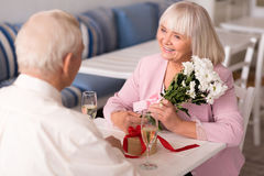 Happy radiant woman thanking her companion Stock Photography