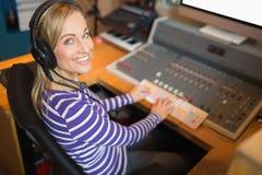Happy radio host wearing headphones Stock Photo