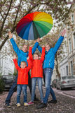 Happy rain family have fun. Family have fun in rainy day in rainy day Royalty Free Stock Photos