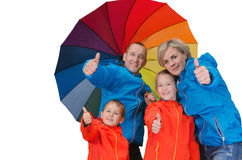 Happy rain family show thumbs up isolated white. Happy rain family with umbrella show thumbs up isolated white Royalty Free Stock Images