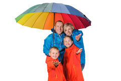 Happy rain  family with umbrella  isolated white. Colorful family mother, father, son, daughter under big umbrella isolated white Stock Images