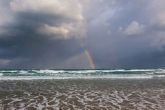 Happy Rainbow on the rainy sea Stock Photography