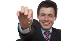 Happy Real estate agent overgives house key. Happy Real estate agent overgives key for flat / house. Isolated on white background royalty free stock images