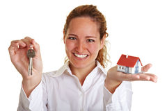 Happy realtor woman with house. Happy realtor woman with small house and keys Royalty Free Stock Photos