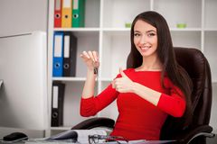 Happy realtor woman showing keys. Business women real estate age Royalty Free Stock Photo