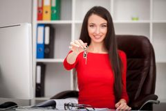 Happy realtor woman showing keys. Business women real estate age Stock Images