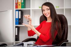 Happy realtor woman showing keys. Business women real estate age Royalty Free Stock Photos