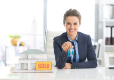 Happy realtor woman showing keys Stock Image