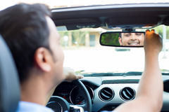 Happy at rearview mirror Royalty Free Stock Photo