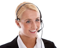 Happy receptionist. Attractive young woman with receptionist headset and a radiant smile Stock Image