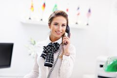 Happy receptionist working in hotel Stock Photography