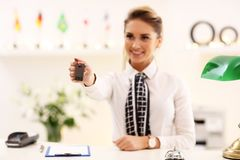 Happy receptionist working in hotel Stock Photo