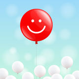 Happy red balloon. Big red balloon with smiling face is flying in the blue sky, many little white balloons below Royalty Free Stock Photos