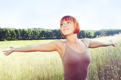 Happy red girl with outstretched Stock Photography