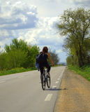 Spring road biker woman Royalty Free Stock Photo